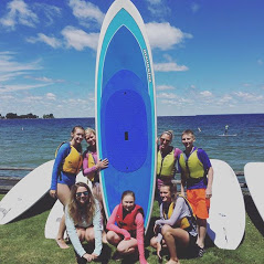 group picture with paddle board