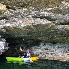 kayaker in a cave